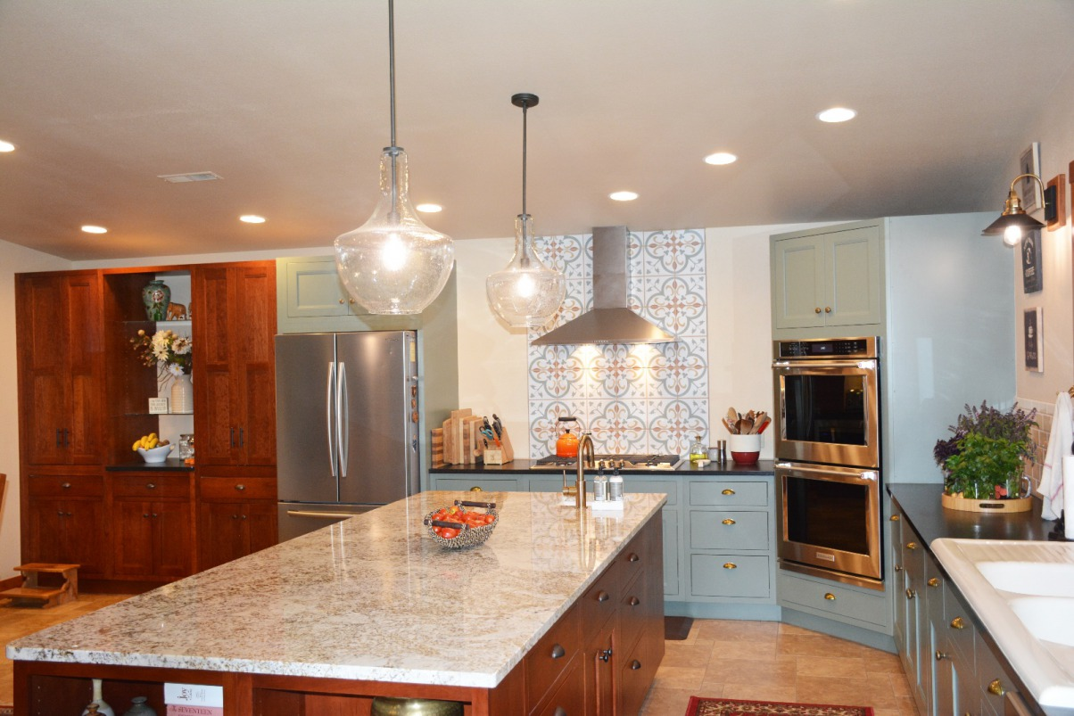 Notice her gorgeous backsplash as well as the uniquely placed angled wall oven.