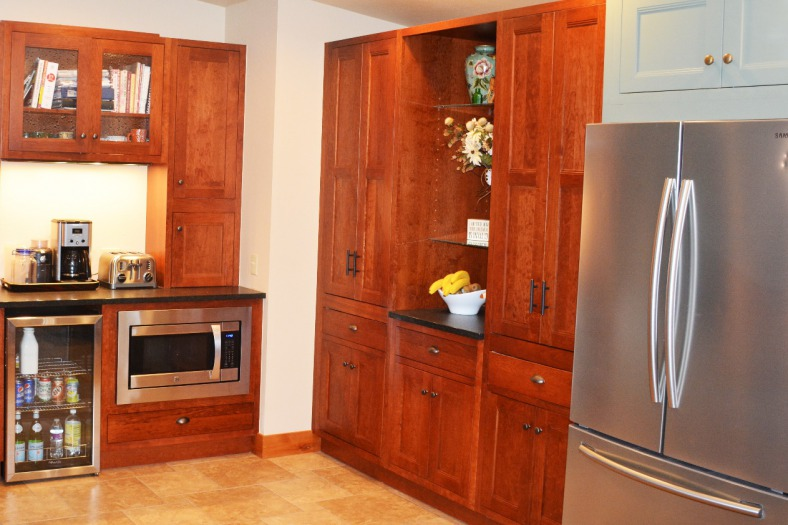 We put together a beautiful beverage center and pantry area to finish off the run of cabinetry.